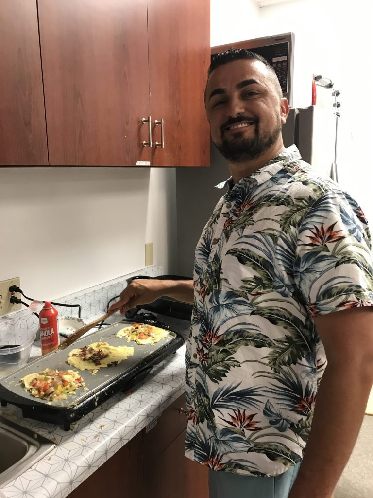 Chandran, shipping and fulfillment manager, cooks up egg scrambles at our Brunch Buffet.